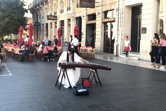 Chinese girl playing guqin music