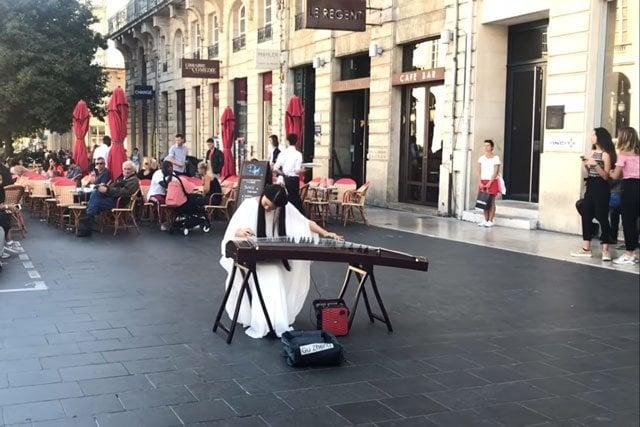 Chinese girl playing guqin music