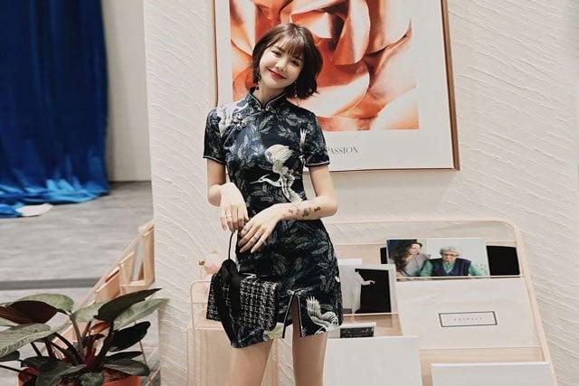 Chinese girl wear a modern print qipao